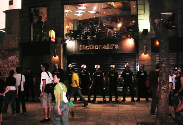 Police guard McDonald's from the gays